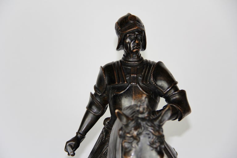 Patinated Bronze Figure of a Soldier on a Horse with a Helmet For Sale 6