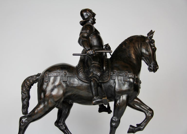 Patinated Bronze Figure of a Soldier on a Horse with a Helmet In Good Condition For Sale In New York, NY