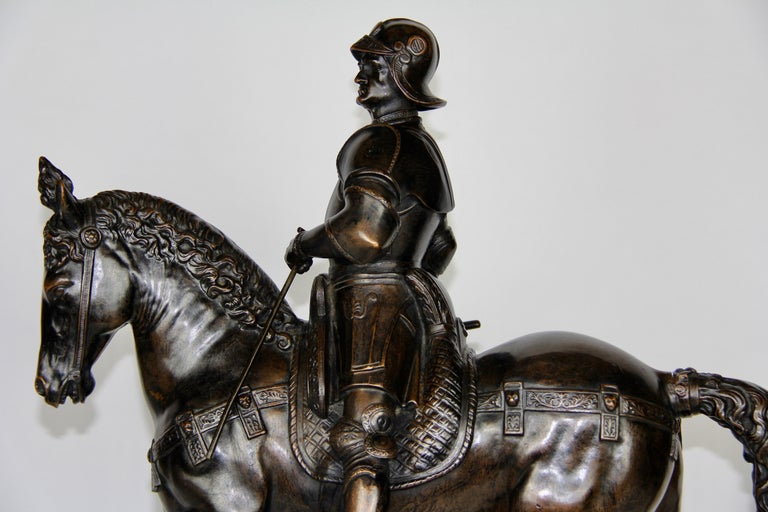 Early 20th Century Patinated Bronze Figure of a Soldier on a Horse with a Helmet For Sale