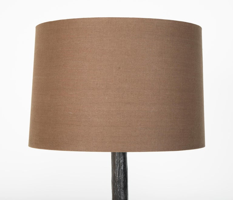 Giacommeti style floor lamp in patinated bronze. Designed by Michael Schaible and Robert Bray.