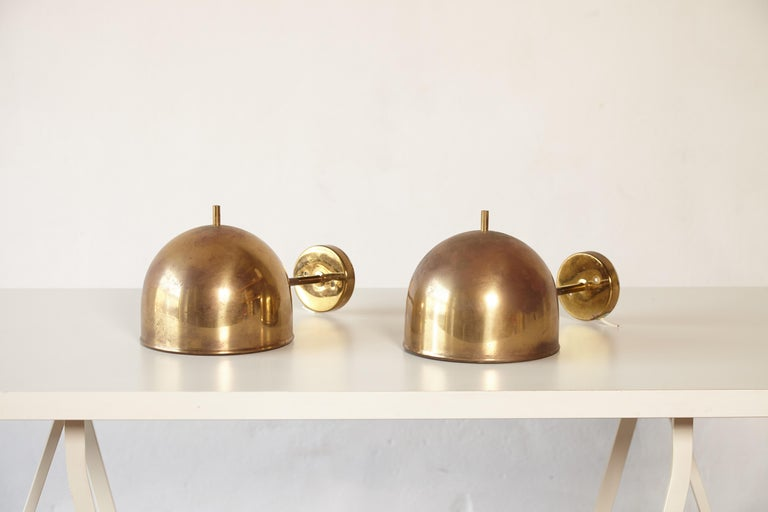 A super patinated pair of brass wall lamps, model G-075, Bergboms, Sweden, 1960s. Priced and sold as a pair.