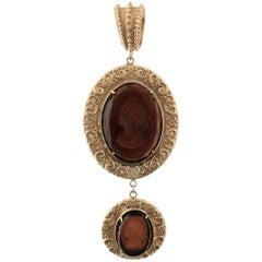 A Patrizia Daliana Bronze Pendant with brown engraved Murano Glass inserts