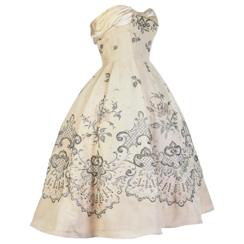 A Pierre Balmain Couture Ballgown numbered 87681 in Cream Silk Circa 1955/1957