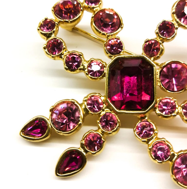A pink paste and gilt metal 'bow' brooch, Yves Saint Laurent, France, 1980s For Sale 1