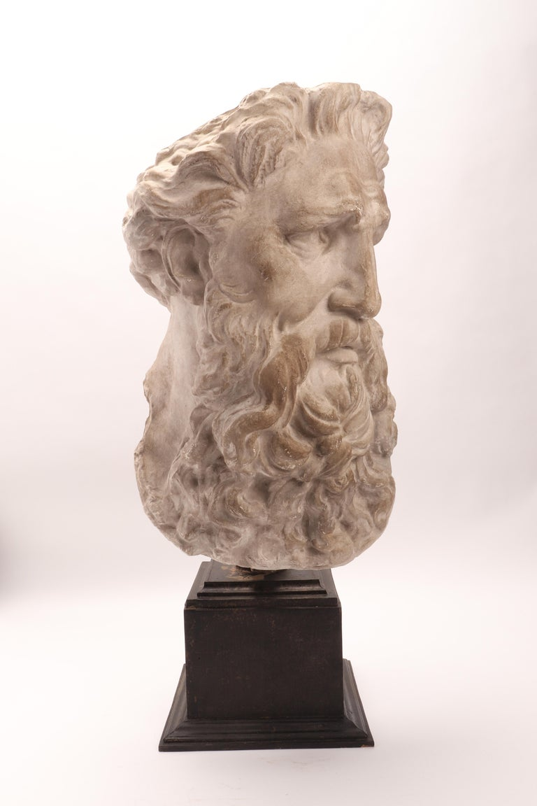 Over the wooden black painted base is set the plaster cast of the head of Neptune. The cast for drawing teaching in Academy. Italy, circa 1890.