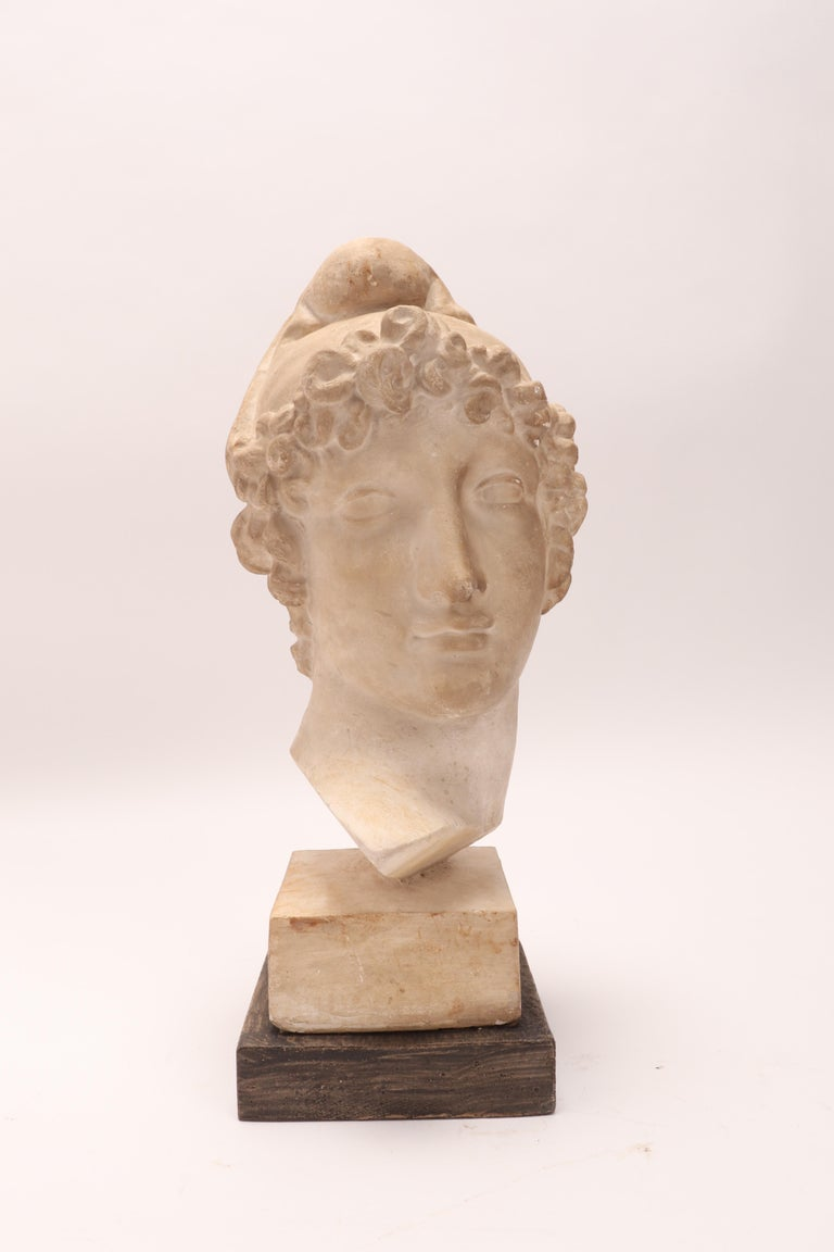 Over the wooden black painted base is set the plaster cast of the head of Paride, da Antonio Canova. The cast for drawing teaching in Academy, Italy, circa 1890.