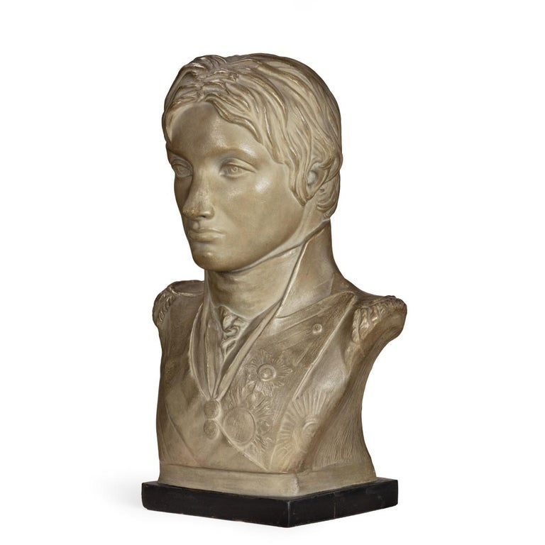 This bust of Admiral Lord Nelson was probably produced by Bartholomew Papera after the 1798 marble bust by Anne Seymour Damer. The reverse is impressed, 'Anna S. Damer Fecit' and 'Pub. As the Act Dir'. Incomplete paper label on the integral black