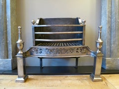 A Polished Steel Antique Fire Grate