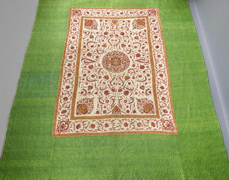 Circa 1720/1750 Coromandel Coast India for the Palampore  France Provence for the quilting  A large quilted bedcover or hanging of an early printed indian Palampore surrounded by a green yellow taffeta silk of the same period. Orderly and