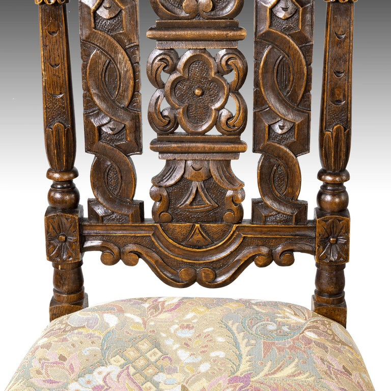 A quite exceptional set of 6 (4+2) 17th century style oak chairs. The backs very finely carved with elaborate scrollwork, foliage and indentations. Heavily pierced and in quite extraordinary condition. Obviously from a first-class workshop. The