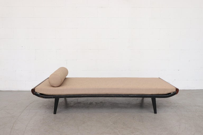 1960s Cleopatra style day bed by A.R. Cordemeyer for Auping with teak ends and dark charcoal grey enameled metal frame with