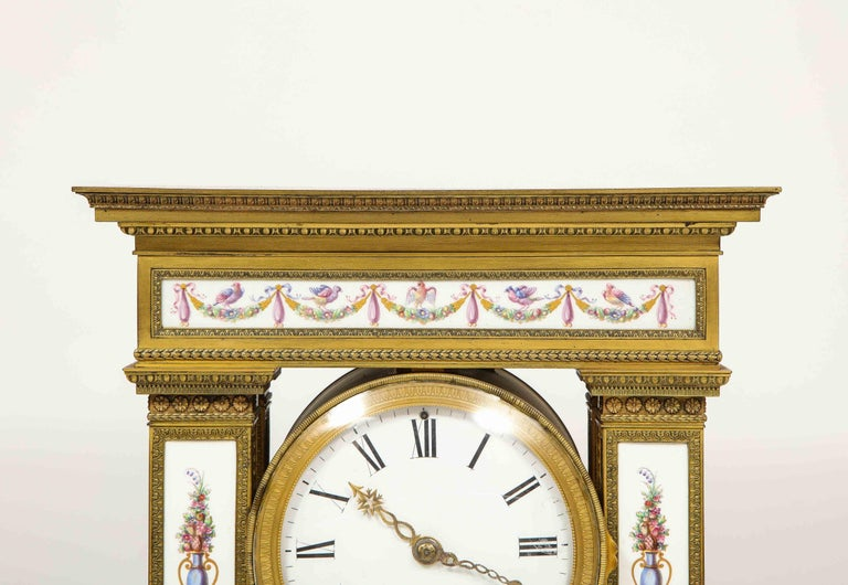 A Rare and Exquisite French Ormolu and Porcelain Clock, attributed to Deniere  In Good Condition For Sale In New York, NY