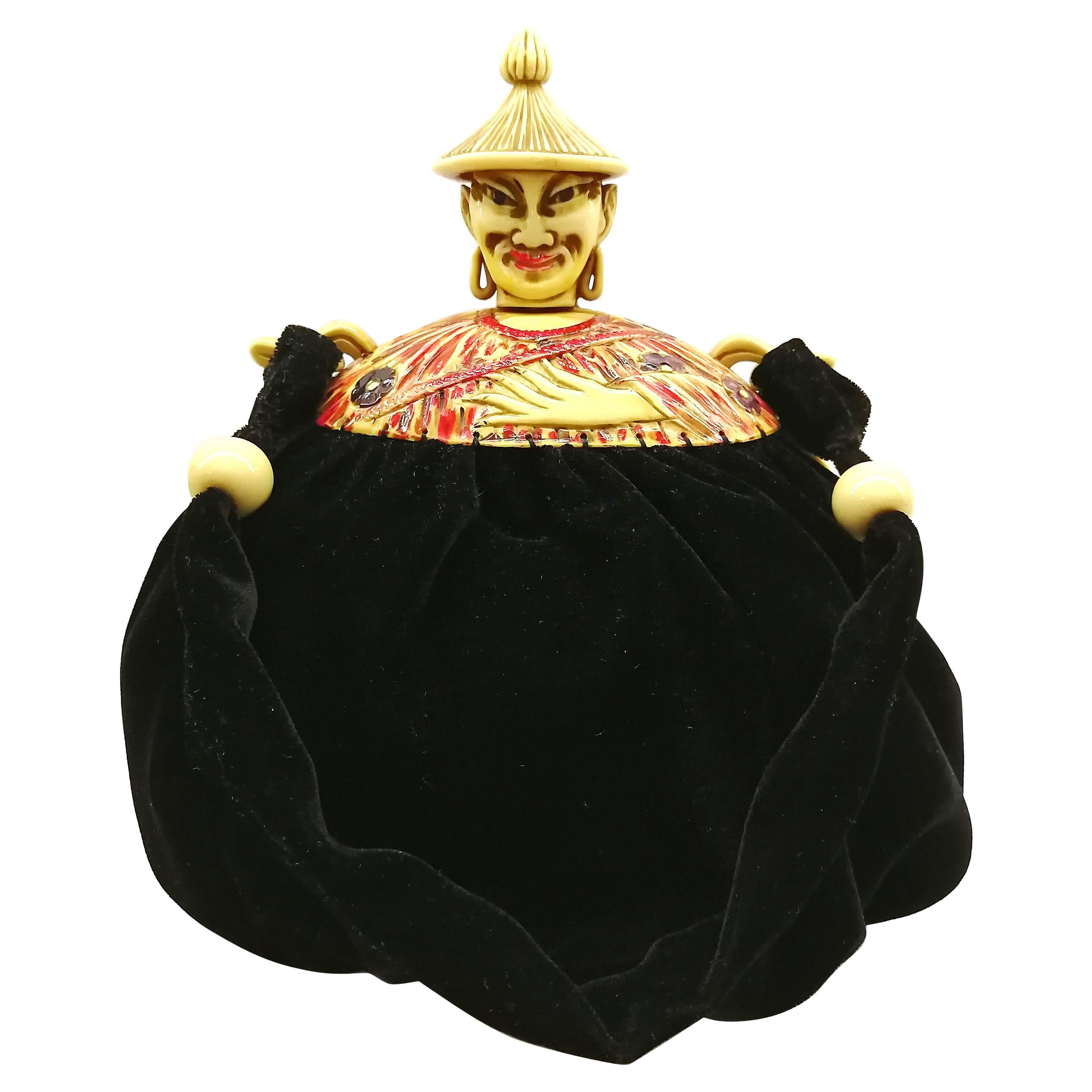 A rare and highly unusual Bakelite topped 'Chinese man' handbag, France, 1920s