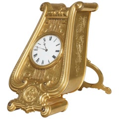 Rare and Unusual Bronze Lyre-Shaped Strut Clock Designed by Thomas Cole