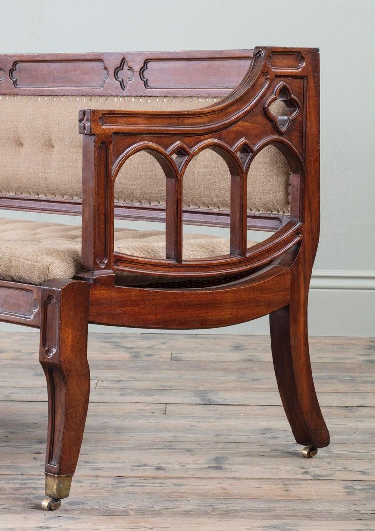British Rare George III Mahogany Saddle Seat Settee of Unusual Gothic Design For Sale
