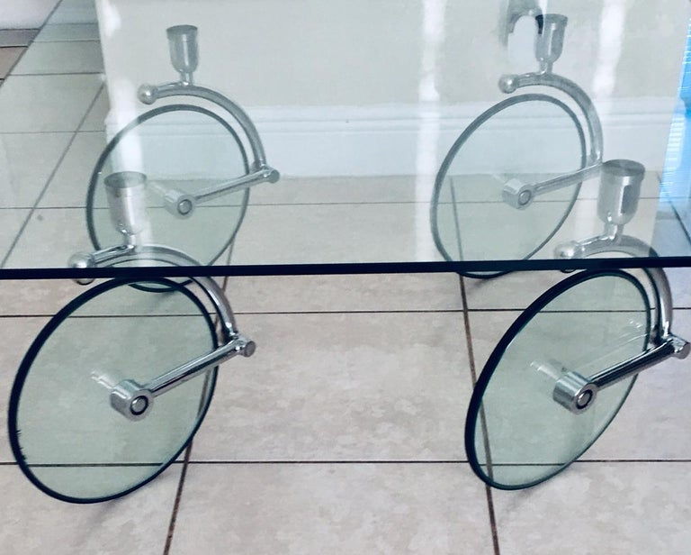 A rare glass table with glass wheels by Fontana Arte. Wheels have rubber covers and the forks are steel.