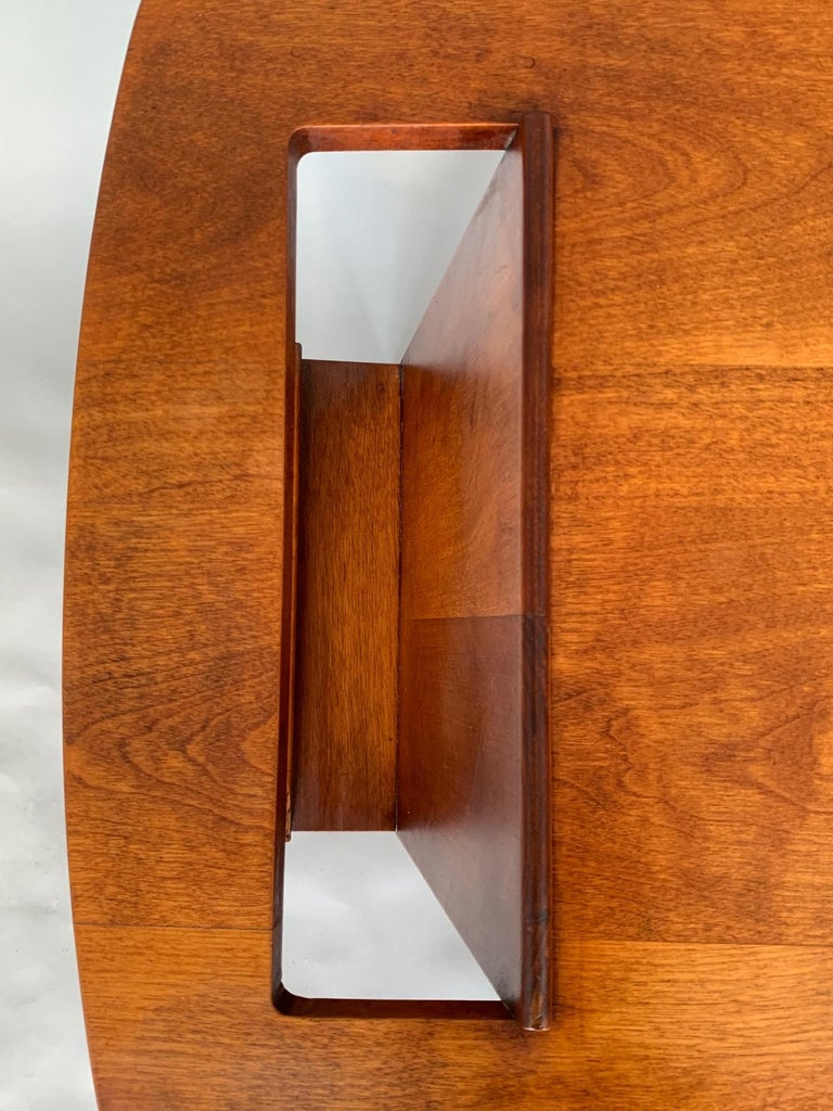 A rare and early production wedge form magazine table by Jens Risom. Beautiful patina and character in very good original condition, circa 1950s.
