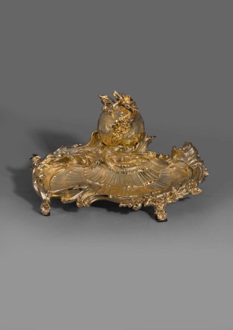 A Rare Louis XV Style gilt bronze Encrier, By Paul Sormani.   French, circa 1870.   Signed 'P. Sormani, Paris' to the underside of the cover.   This finely cast and chased gilt bronze encrier is of rocaille form with scrolling leaves and branches