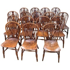 Rare Matched Set of Sixteen 19th Century Windsor Draught Back Chairs