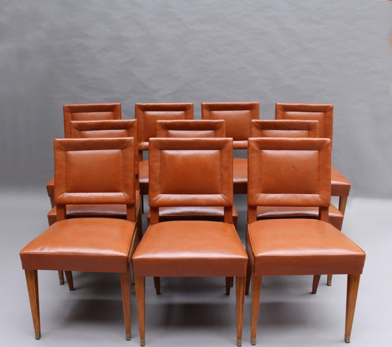 Jacques Quinet – An elegant and rare set of 10 mahogany dining chairs with original leather upholstery and Quinet's signature bronze
