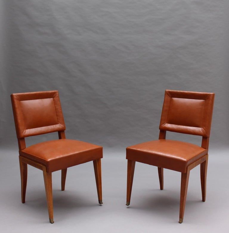 Rare Set of 10 Leather and Mahogany Chairs by Jacques Quinet In Good Condition For Sale In Long Island City, NY