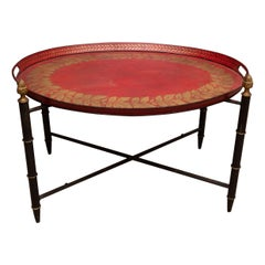 Red Tole Table with Decorative Oval Top and X-Frame Base