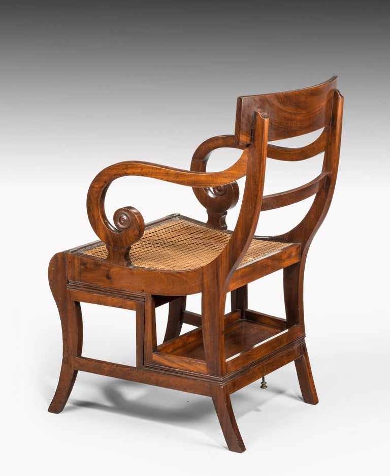 A good example of a Regency period metamorphic sabre legged library chair. Very much in the metier of Morgan and Sanders. Fine timbers.   Measures: As steps height 29 inches, width 19.5 inches. Seat height 17.5 inches.  The Metamorphic Furniture of
