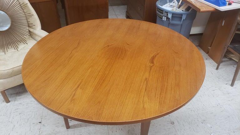 A round Hans Wegner keyhole dining table in teak.