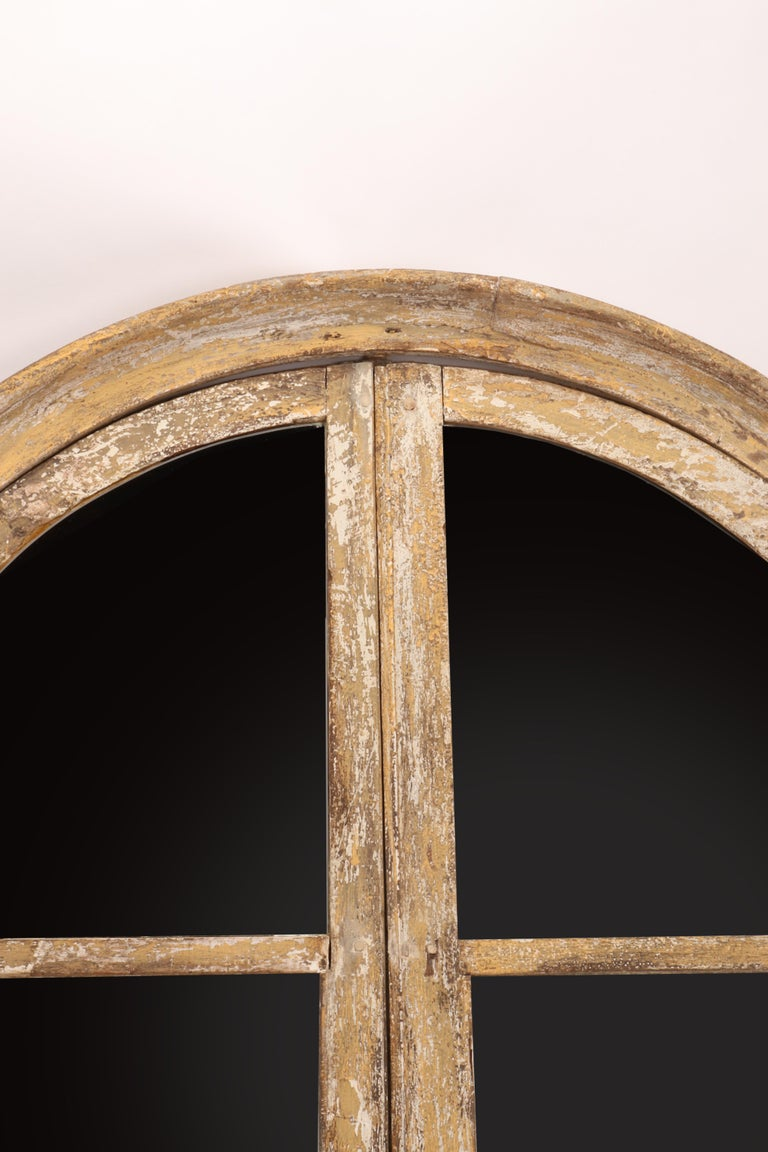 A fine example of reinterpretation and realization of an antique 18th century architectural element. A wooden round window of an old house, with original hinges, have been reused as a mirror. The frame is made out of painted wood, white color,