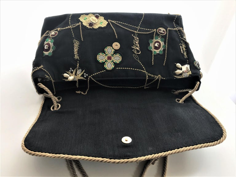 A totally unusual and unique Chanel bag made of black denim, adorned with many Chanel Icons and jewels from Chanel. It is a prototype Autumn 2007-2008 and was only produced once.  IT WAS MADE ONLY FOR THE RUNWAY and has no ID number or card. The bag