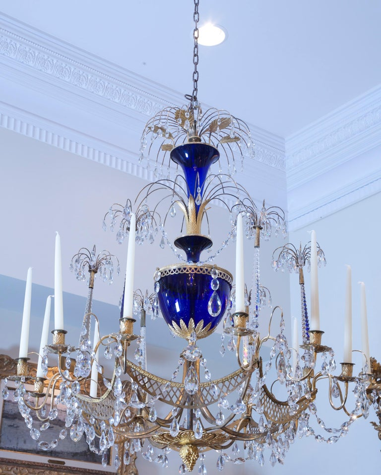 A rare and important Russian late 18th Century twelve candle crystal chandelier attributed to the renowned firm of Johann Zekh. Crafted in Saint Petersburg of mercury-gilded bronze, cobalt blue glass and intricately cut crystal in an exuberant