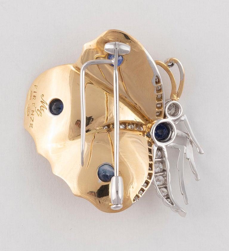 The pavé-set single-cut diamond wings, to a pavé-set single-cut diamond and sapphire single-cut body, length 4cm.