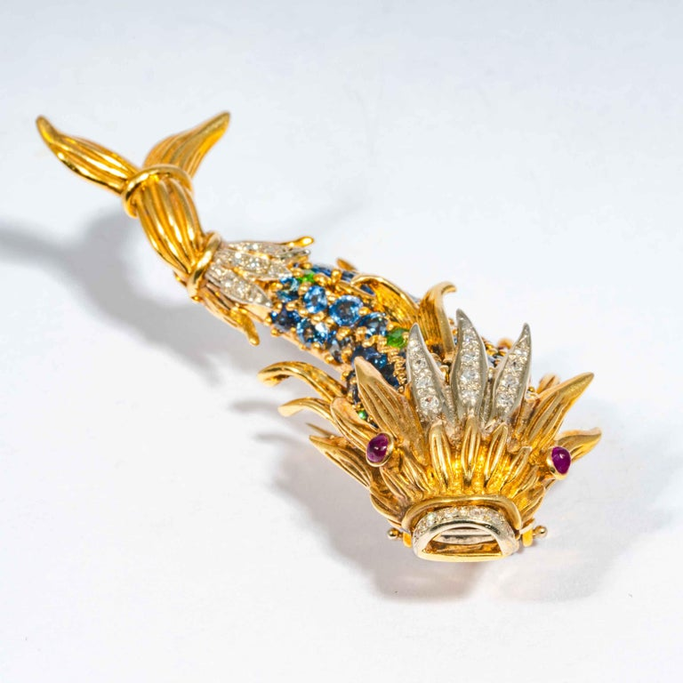 This mid-late 20th century pin is comprised of full cut blue Ceylon sapphires, and accenting gemset white diamonds fish