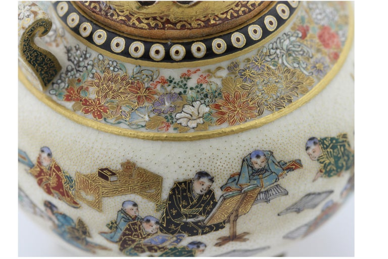 A Satsuma Earthenware Incense Burner by Yabu Meizan, Osaka, 1853-1934,  Of archaic Chinese form set on tripod feet and decorated in polychrome enamels and gilt over a clear, crackled glaze, delicately painted with a continuous design of children