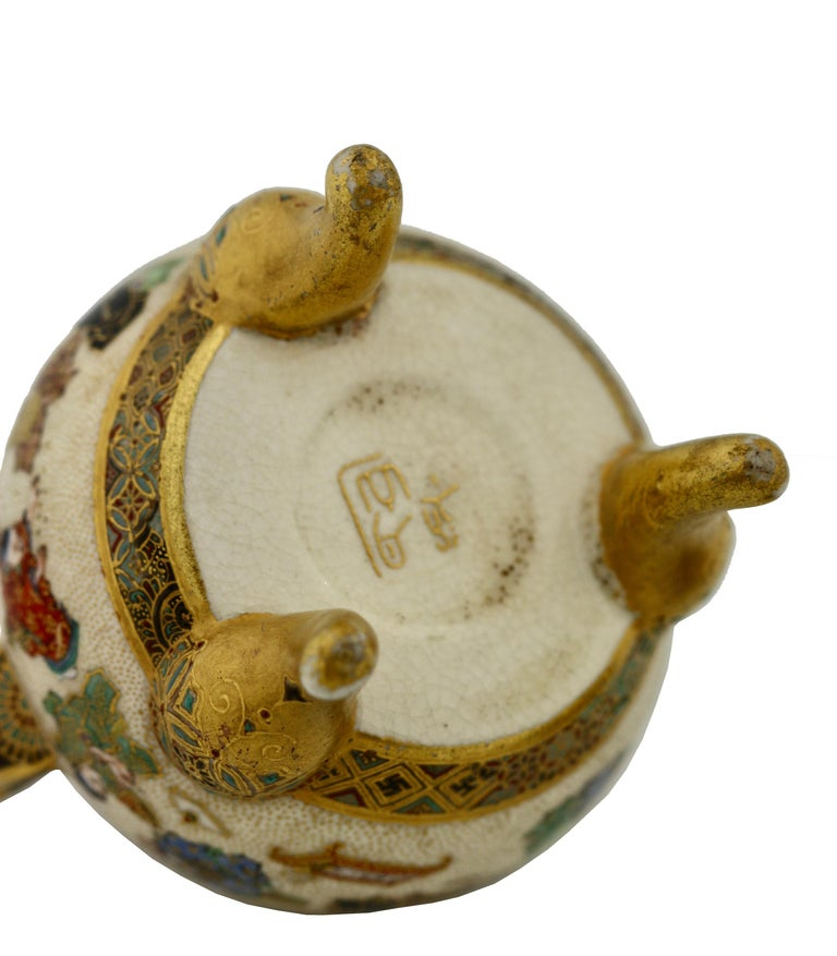 A Satsuma Koro and cover by Yabu Meizan, Osaka, 1853-1934, delicately painted with various scenes of children playing, the top with lion finial, raised on three scrolling feet, with gilt seal Yabu Meizan, height 3 1/2 inches.