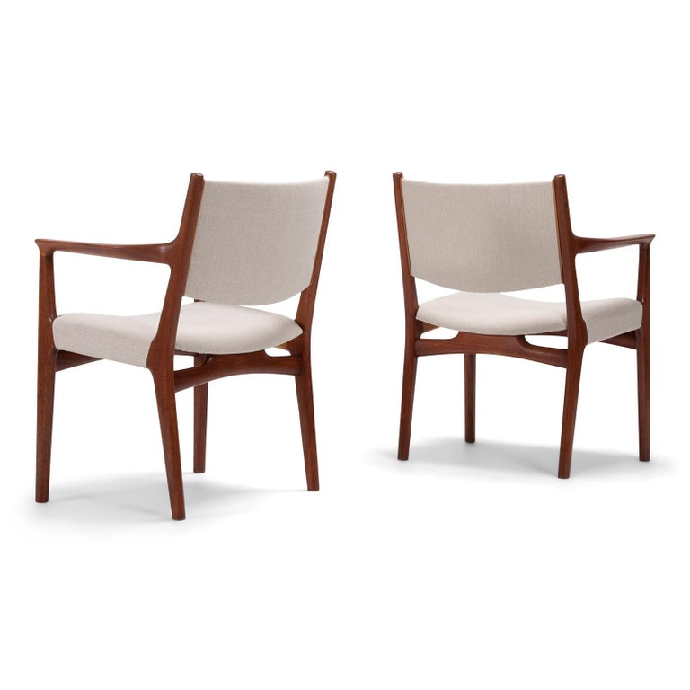 A large set consisting of two armchairs and 8 dining chairs in teak, re-upholstered in linen canvas Designed by Hans Wegner in the 1960s. Handcrafted by master cabinetmaker Johannes Hansen, Denmark.