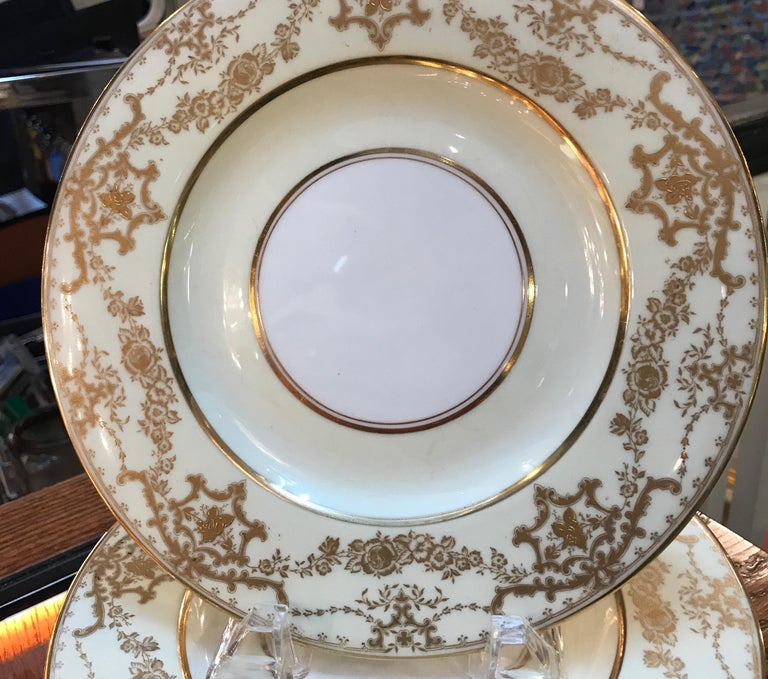 Elegant set of 10 gilt bordered luncheon dessert plates by George Jones, England. Elegant borders with a vanilla background with gilt bands and floral swags. Retailed by Davis Collamore NYC. 9
