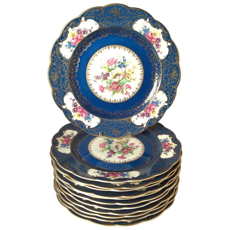 The deep blue and white background with gilt highlights with Dresden floral centers and borders.