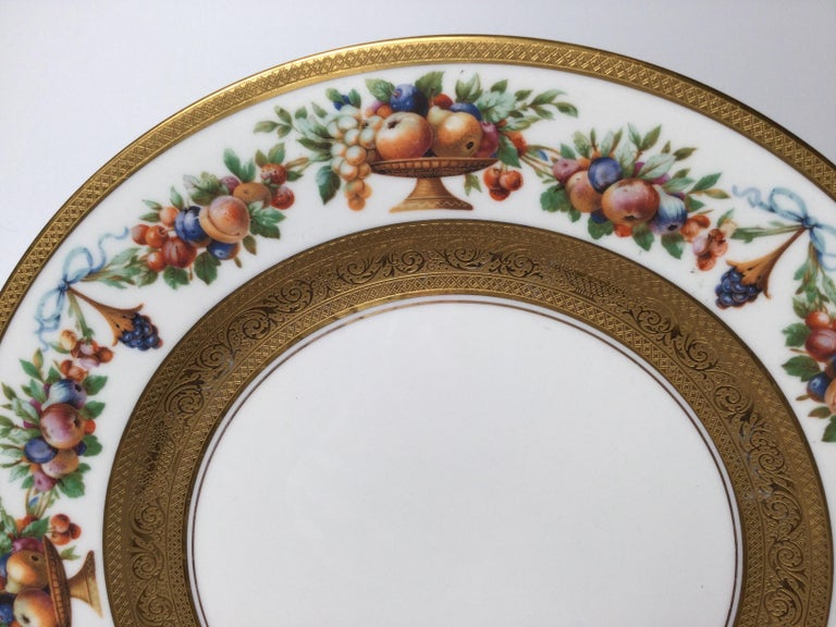 German Set of 12 Gilt Banded Service Dinner Plates with Fruit Borders For Sale