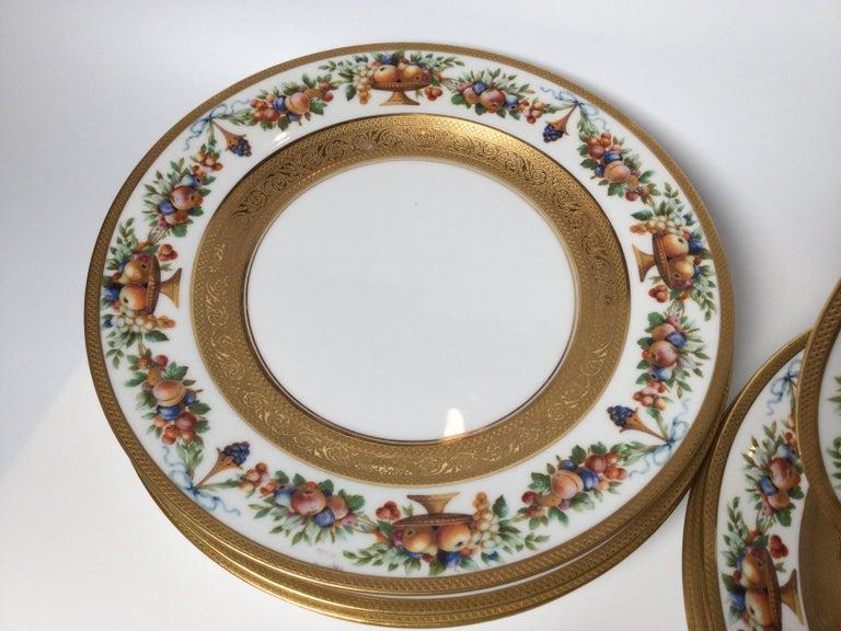 Porcelain Set of 12 Gilt Banded Service Dinner Plates with Fruit Borders For Sale