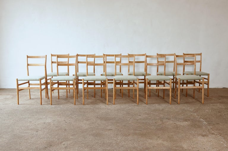 A wonderful set of twelve original, early Gio Ponti Leggera Model 646 dining chairs, Cassina, Italy, 1950s. In restored condition with new upholstery. All with maker's label marked 'Figli di Amedeo Cassina' under each seat.