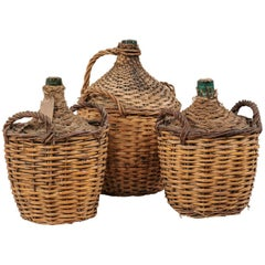 Set of Three French Midcentury Vintner Woven Baskets with Demijohn Wine Bottles