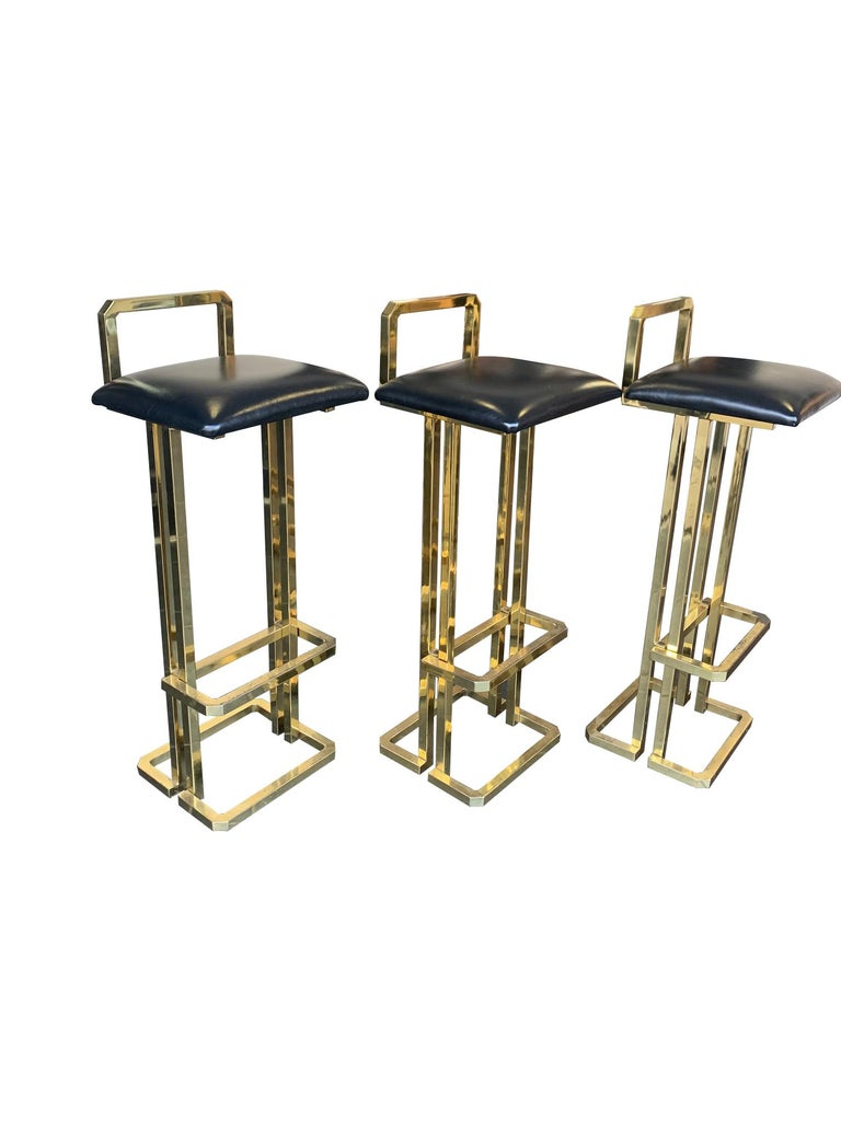 Mid-Century Modern Set of 3 Maison Jansen Style Gilt Metal Stools with Black Leather Seat Pads For Sale