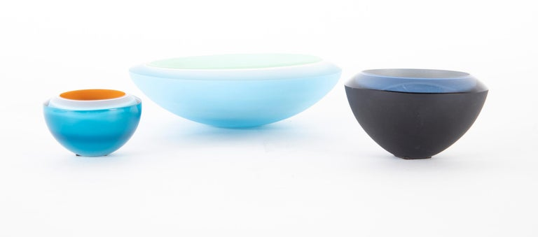 Three Rachael Woodman 3 color cased glass bowls. All 3 are signed and dated with location of creation on underside.   Rachael Woodman has been a glass artist for nearly thirty years and has been designing for Dartington Crystal for the past