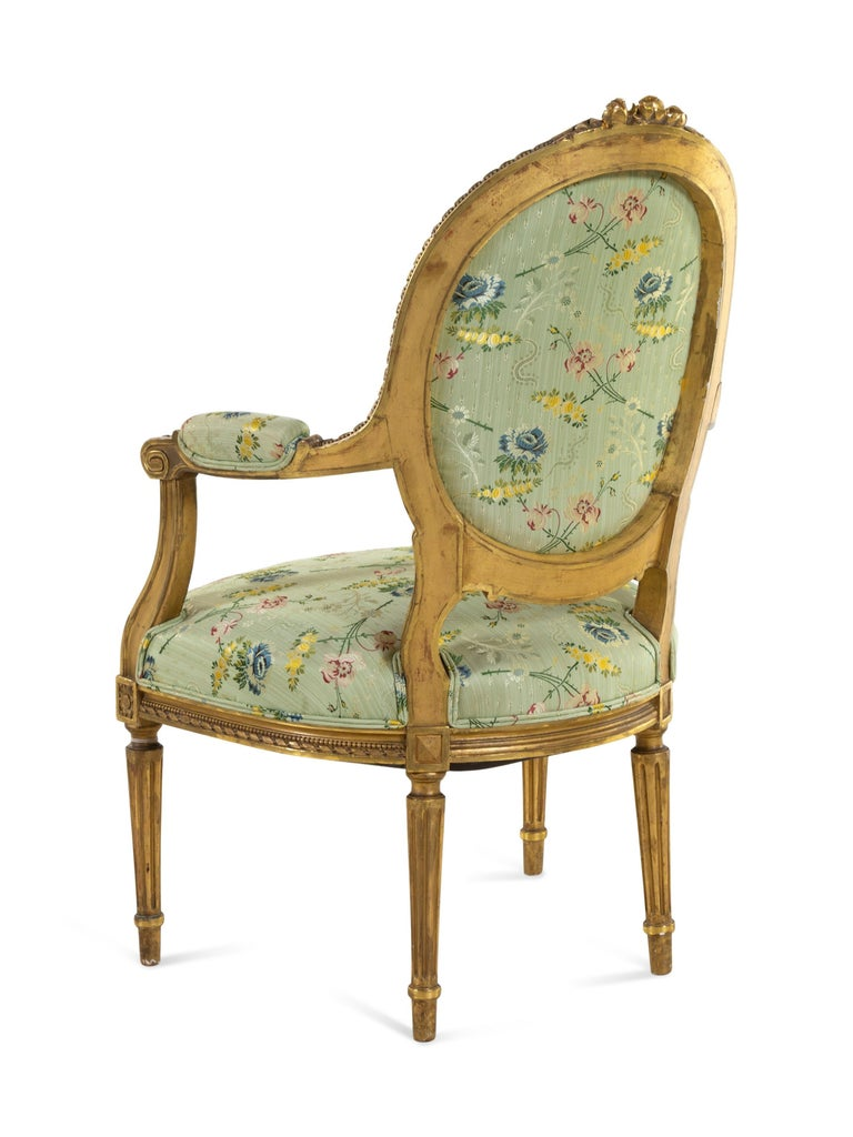 18th Century Set of 4 Early 19th Century French Louis XVI Giltwood Oval Back Armchairs For Sale