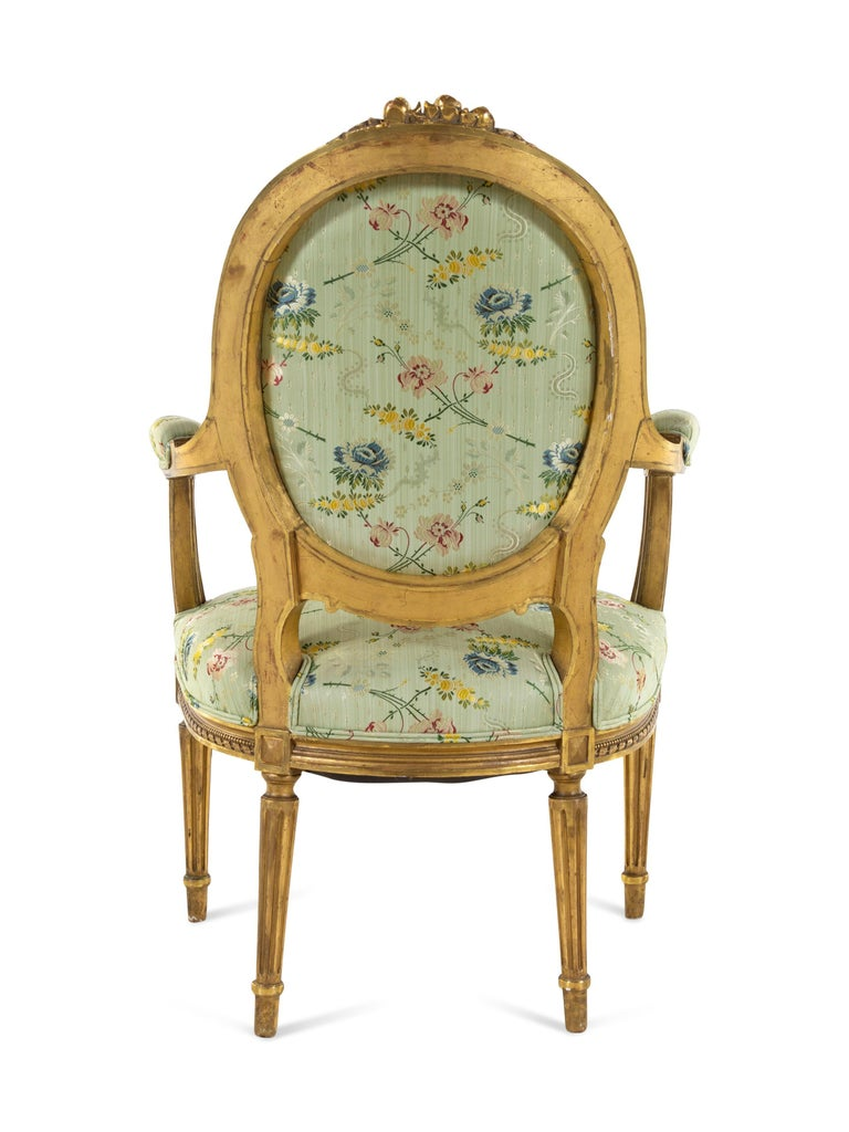 Wood Set of 4 Early 19th Century French Louis XVI Giltwood Oval Back Armchairs For Sale