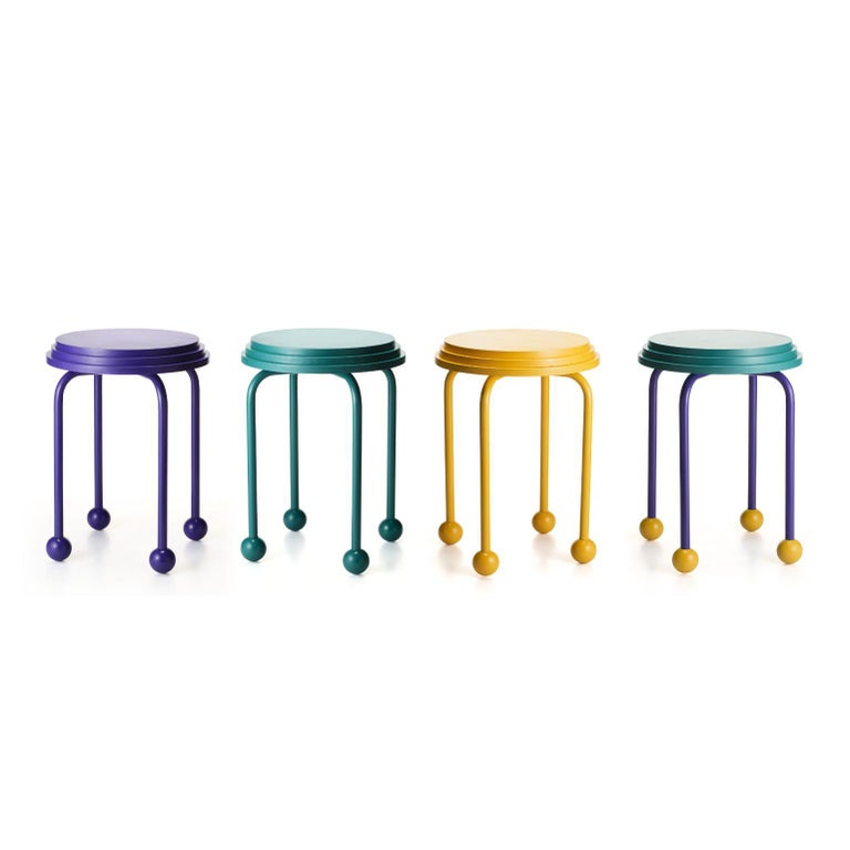 A set of 4 ovni - Benches by Cultivado Em Casa Dimensions: 38 x 38 x 45 cm Materials: MDF, carbon steel, resin, painting in duco paint  Also available: tricolor, purple, green  After a long intergalactic journey, UFO lands in the form of a