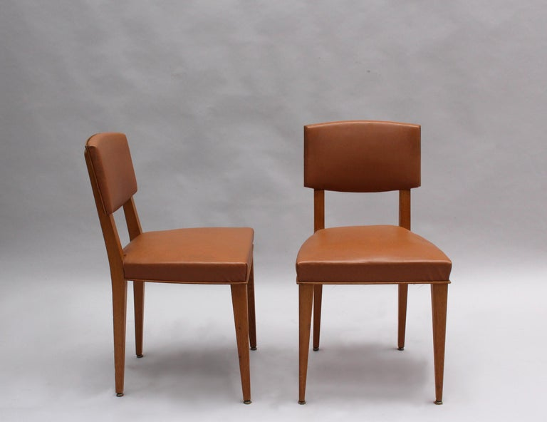 A set of six French midcentury oak chairs.