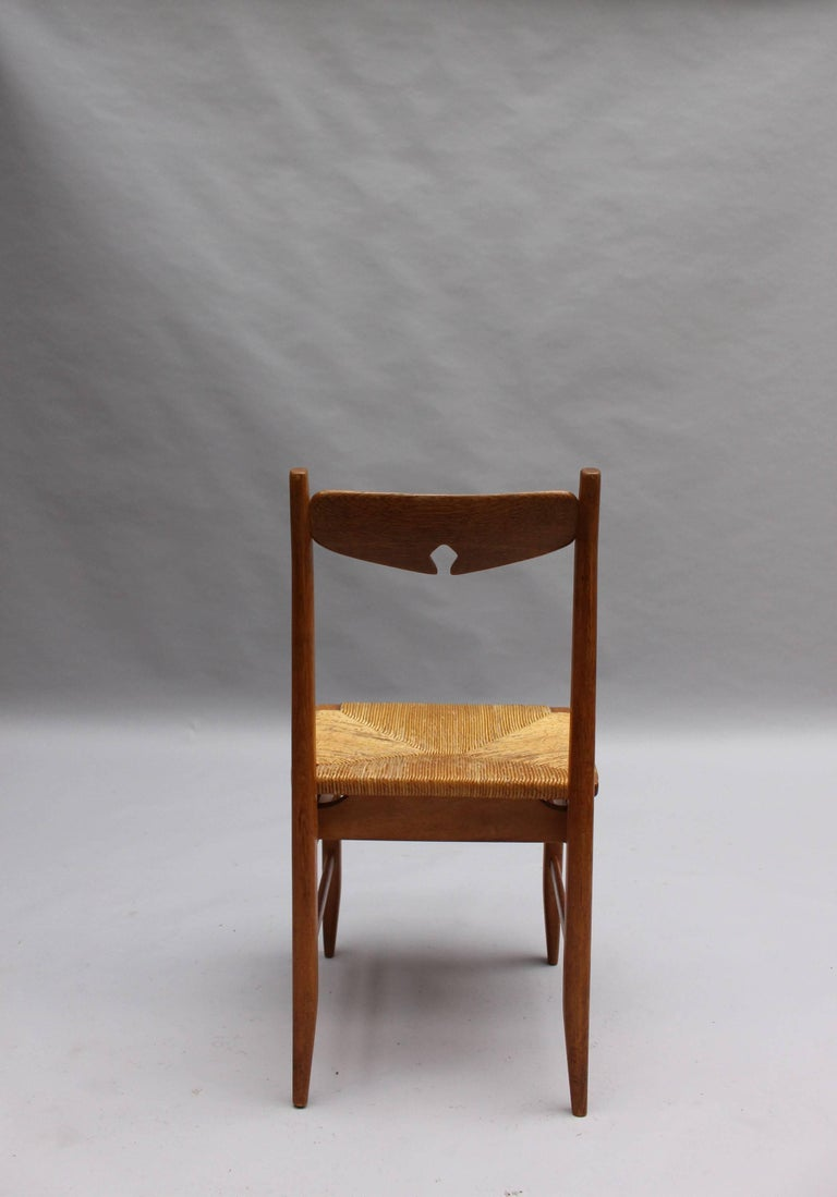Set of Six French Mid-Century Dining Chairs by Guillerme et Chambron For Sale 4