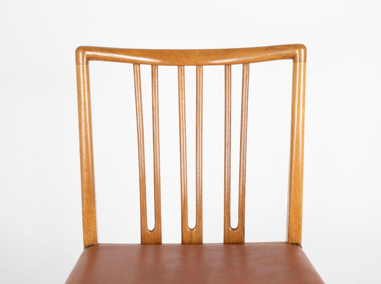 Danish Set of 8 Dining Chairs with Leather Seats by Hans Wegner & Mikael Laursen For Sale